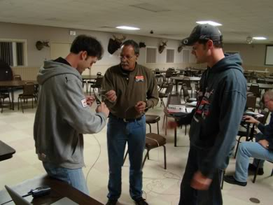 Tim (KB1HNZ), Charlie (W1CPS), and Thom (W1WMG) work together on building a 20 meter dipole